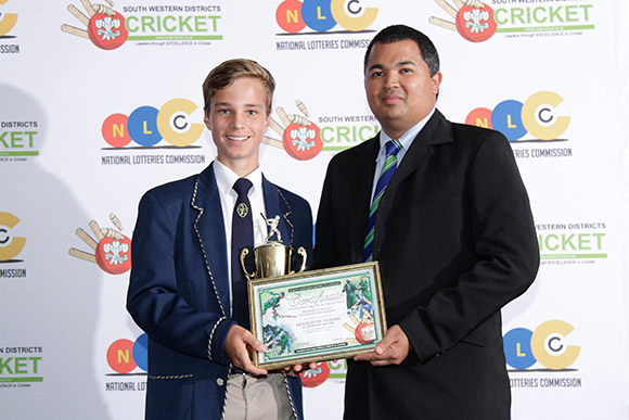 SWD Cricket - Arnaud du Plessis (left) receives the trophy as SWD Primary Schools Player of the Season from Mr Rustin Constance