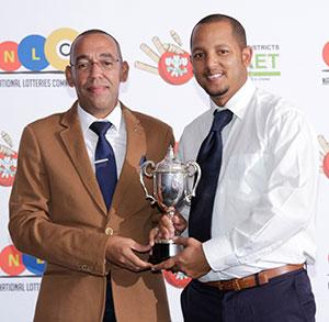 SWD Cricket - Carlos Koeberg receives the trophy as league winners