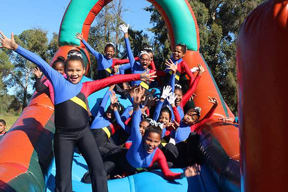 SWD Cricket - Sacred Heart drum majorettes enjoyed themselves at the Jumping Castle
