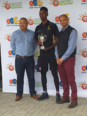 SWD Cricket - Mihlali Gcanga receives the trophy as winners of the SWDC Promotion league